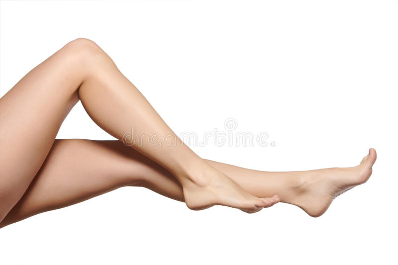 Young woman legs. Young adult's woman legs: beautiful shape, perfect skin. Isolated on white background stock photo