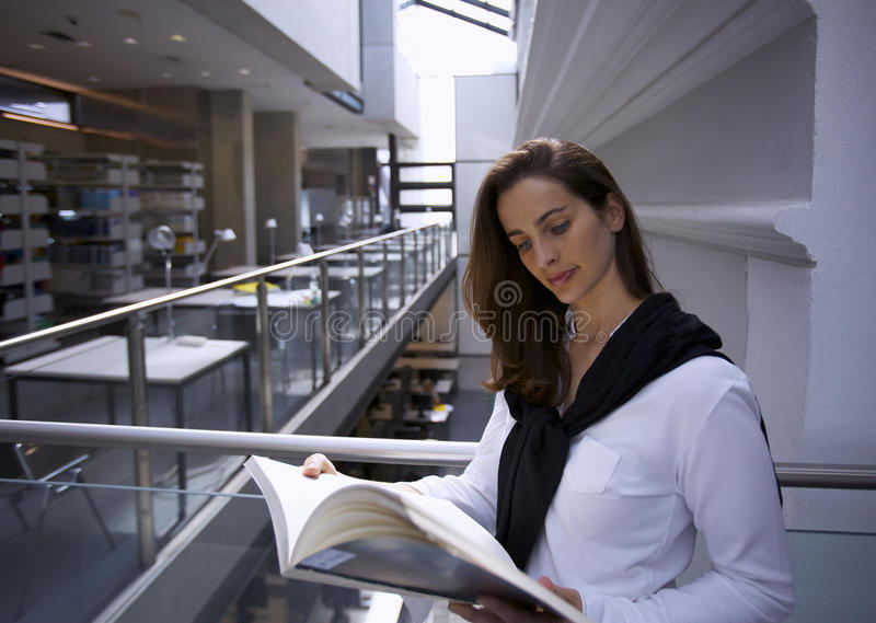 Download Young woman in library stock image. Image of adult, college - 13731779