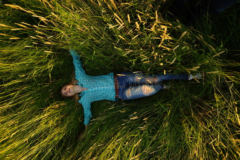Download Young Woman Lie In The High Grass Stock Photo - Image: 38694886