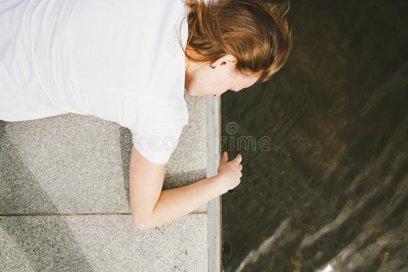 Portrait of the beautiful young woman in white t-shirt outdoors. Top view stock images
