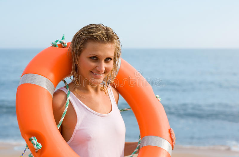 Young woman with a lifbuoy stock photography