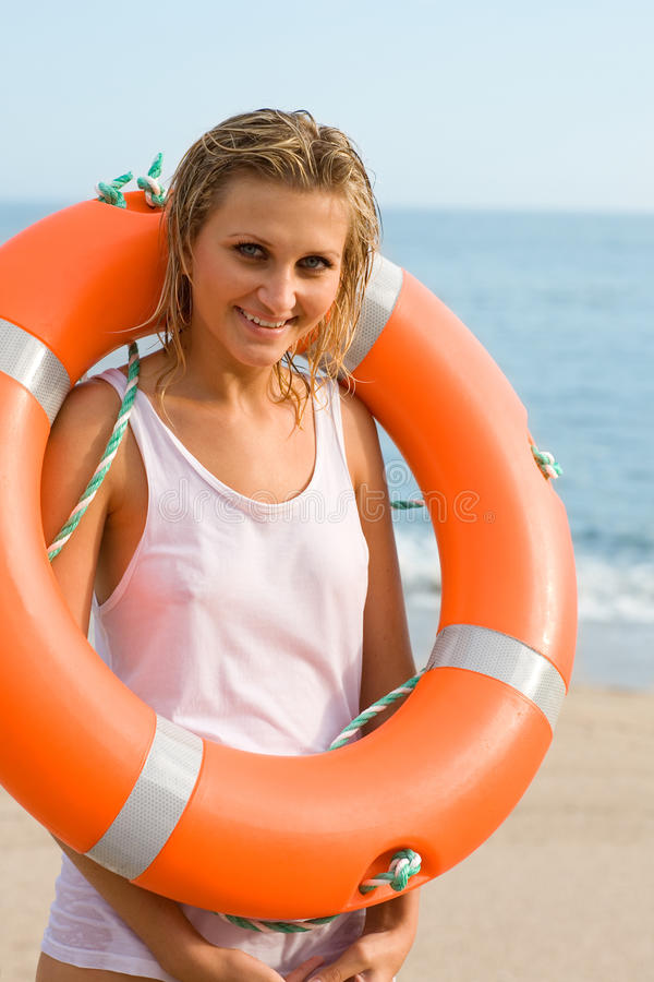 Young woman with a lifebuoy royalty free stock photo