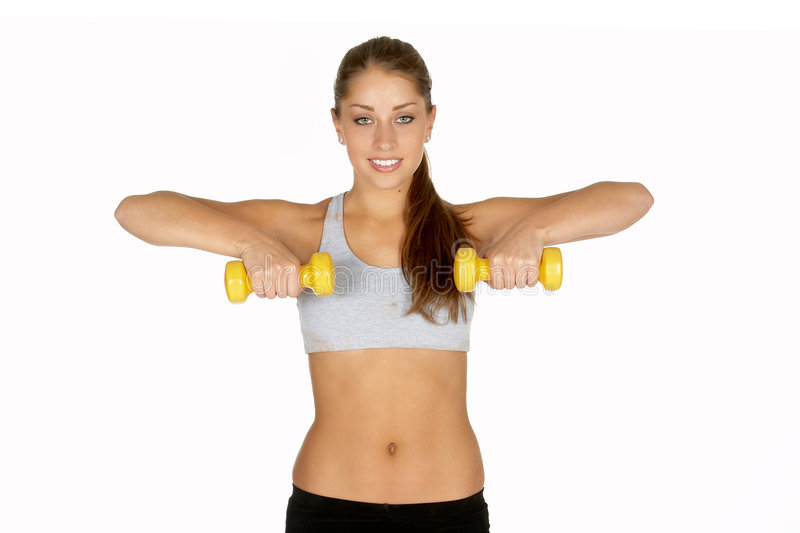 Young Woman Lifting Dumbells stock photo
