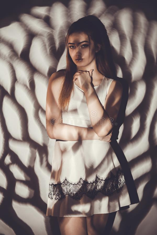 Young woman with light pattern concept beauty and and mystery, gobo masks royalty free stock images