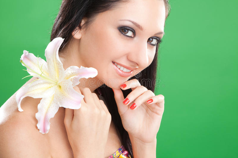 Young woman with lily flower royalty free stock image