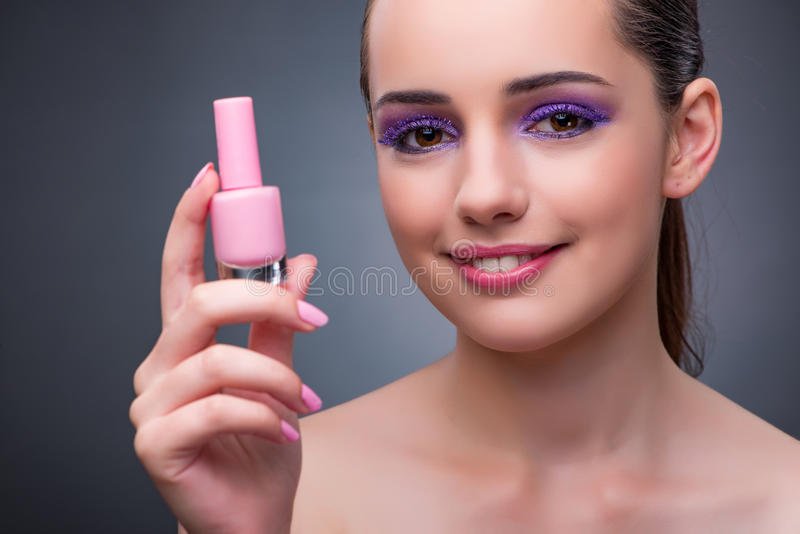 The young woman with lipstick in beaut concept. Young woman with lipstick in beaut concept royalty free stock images