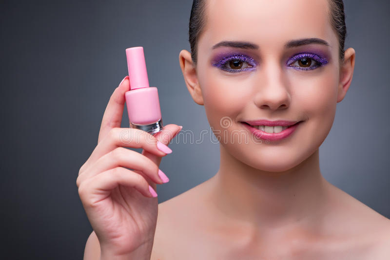 The young woman with lipstick in beaut concept. Young woman with lipstick in beaut concept royalty free stock photos