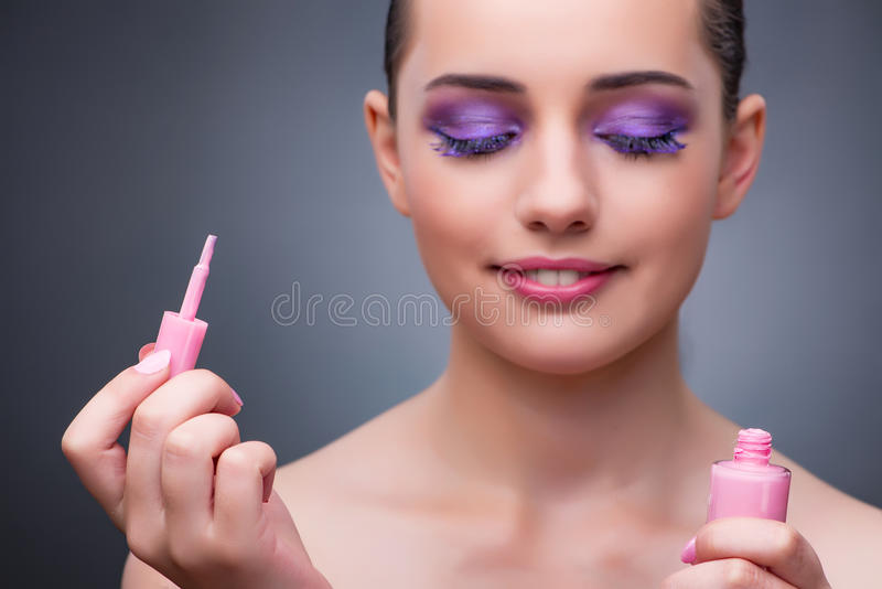 The young woman with lipstick in beaut concept. Young woman with lipstick in beaut concept stock photography