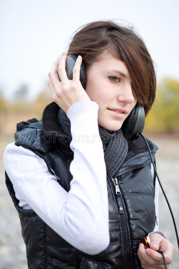 Young woman listen to music stock image