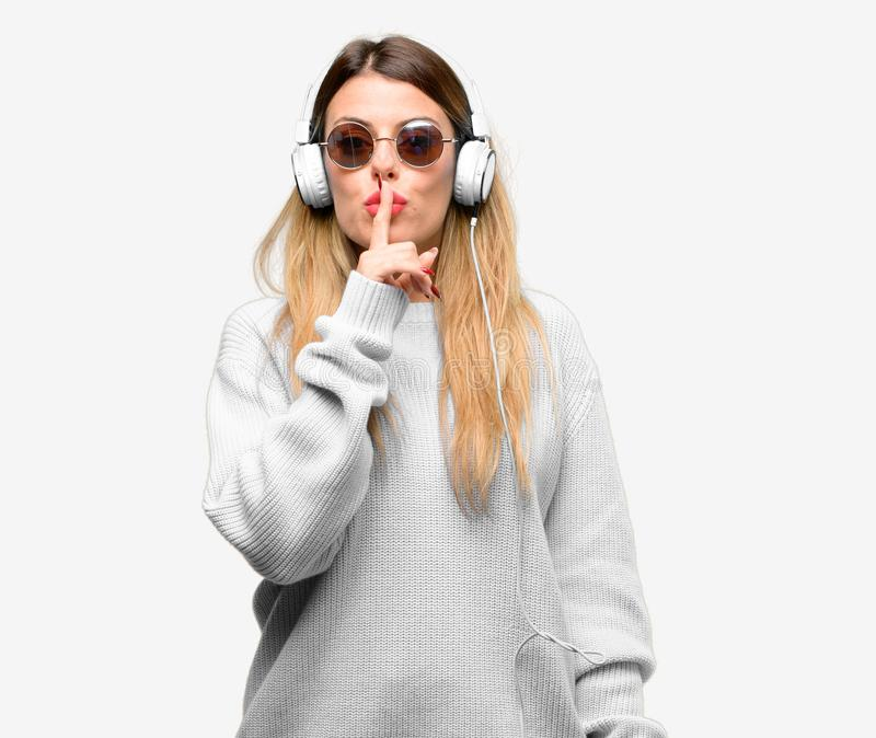 Young cool student woman with headphones royalty free stock image