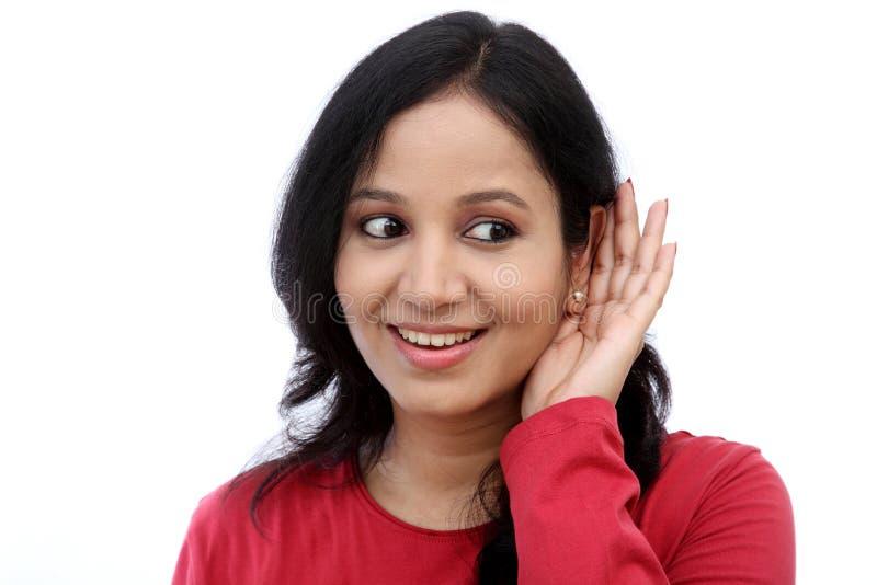 Young woman listening gossip stock photos
