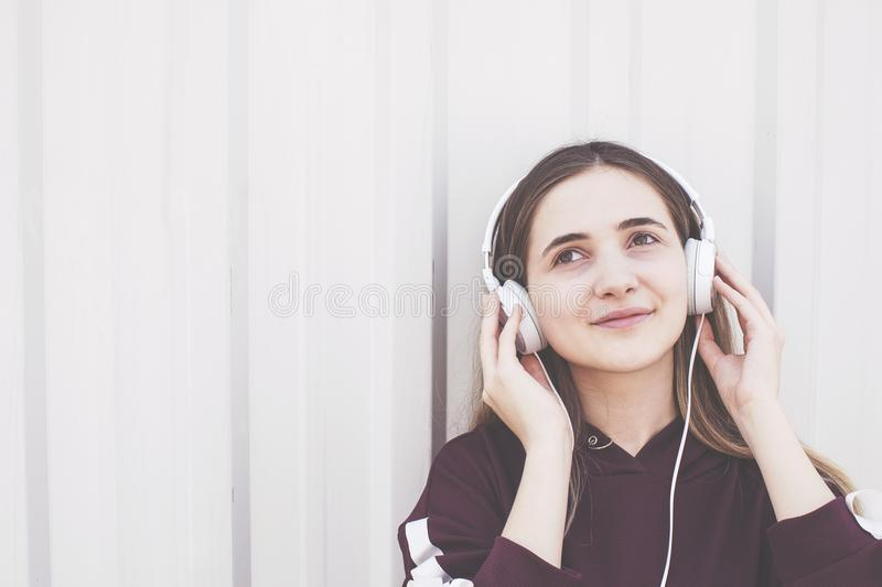 Young woman listening music with earphone royalty free stock photo