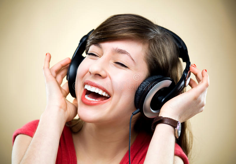 Download Young Woman Listening To Music Stock Photography - Image: 23152702