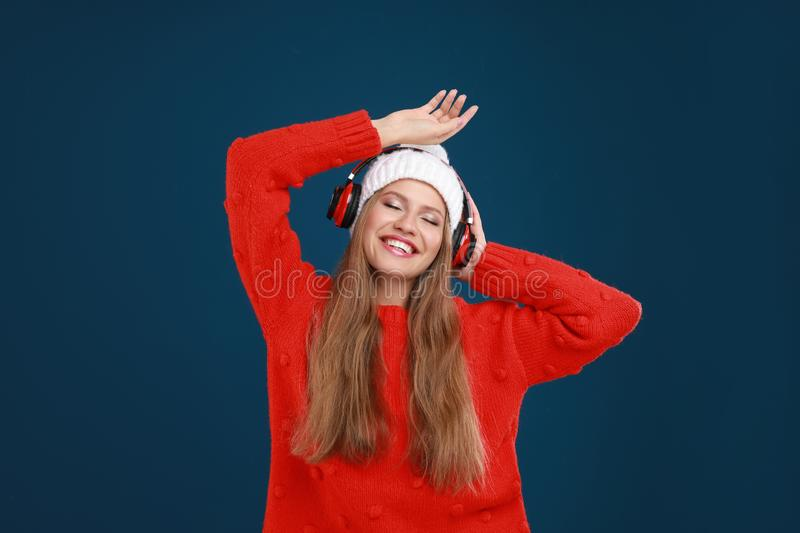 Young woman listening to music with headphones royalty free stock image