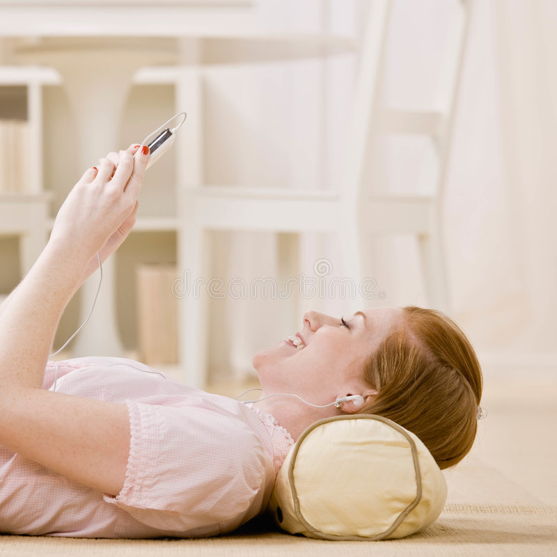 Download Young Woman Listens To Music On Mp3 Player Stock Image - Image: 6604977