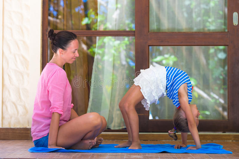 Young woman and little girl engaged in fitness royalty free stock photos