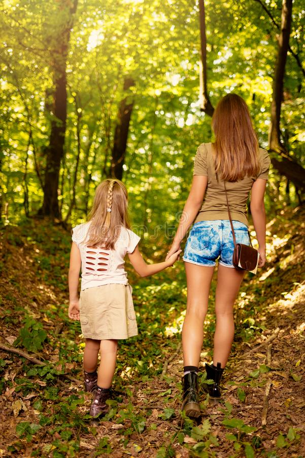 Young Woman And Little Girl In The Forest stock photo