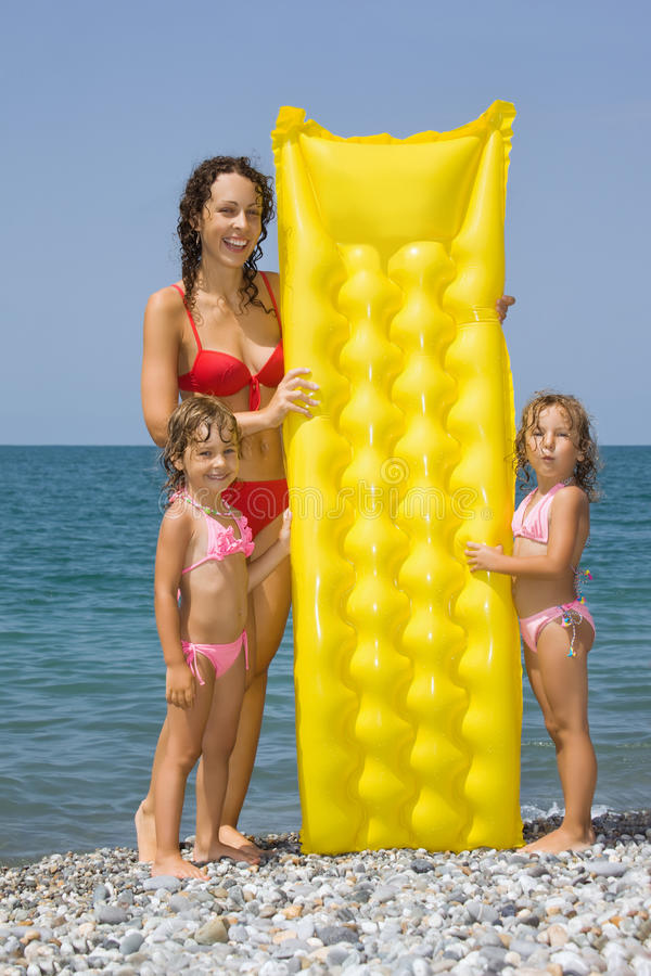 Download Young Woman And Little Girls Standing On Beach Royalty Free Stock Image - Image: 13300876