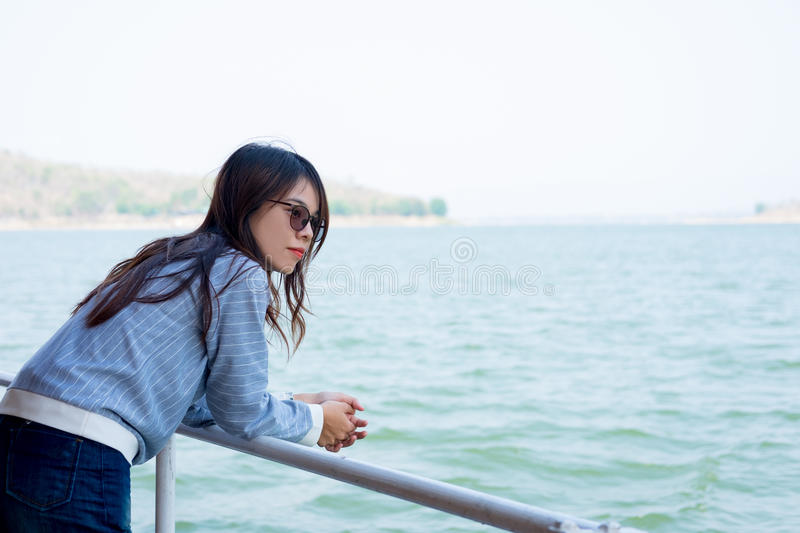 Young woman lone moment standing viewing scenery on boat. front stock photos