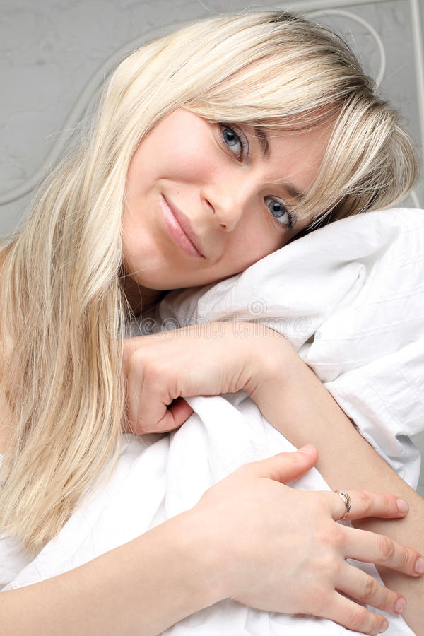Young woman with long blond hair in the morning royalty free stock images