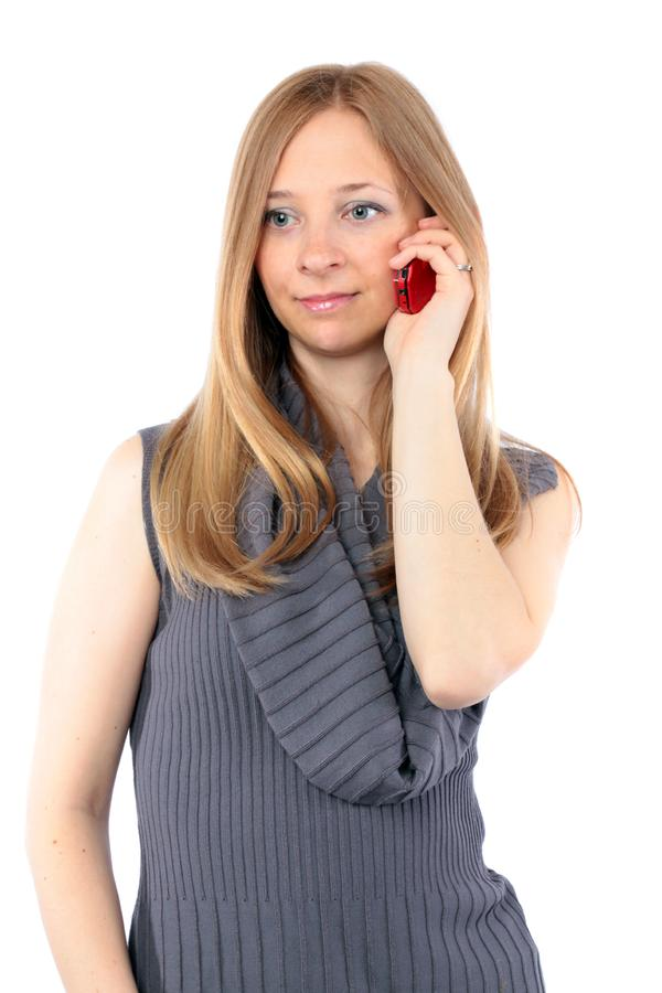 Young woman with long blond hair talking on phone royalty free stock images