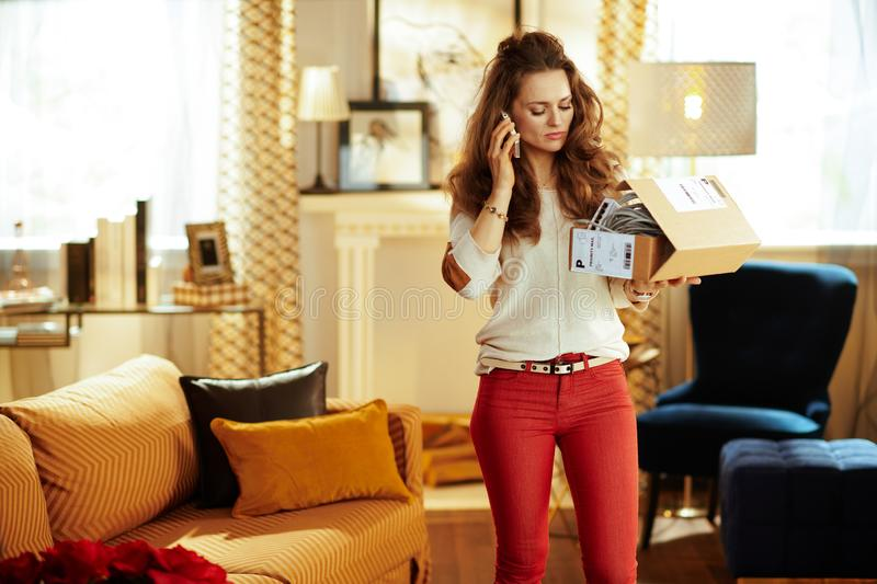 Woman and trying to return problematic or unsuitable smart home stock photography