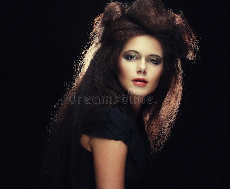Young woman with long colored brown hair and bright make-up stock photo