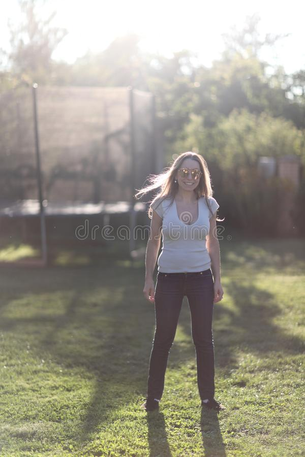 Young woman on a green lawn stock photo