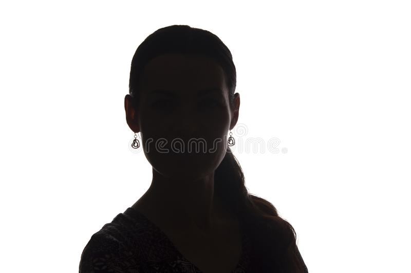 Young woman look ahead with lock of hair - silhouette stock photography