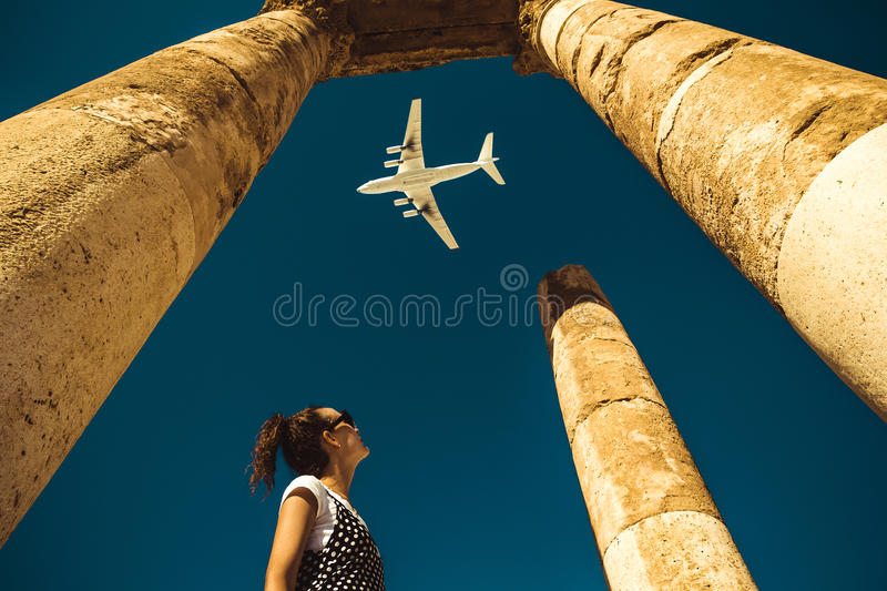 Young woman look at airplane dreaming about vacation. Explore the world. Export concept. Time to travel. Freedom life. Independent stock images