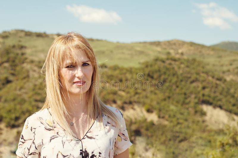 Young woman looking at amazing view of hlls in Albania royalty free stock photos