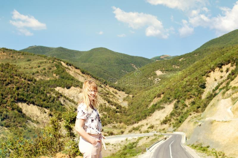 Young woman looking at amazing view of hlls in Albania stock image