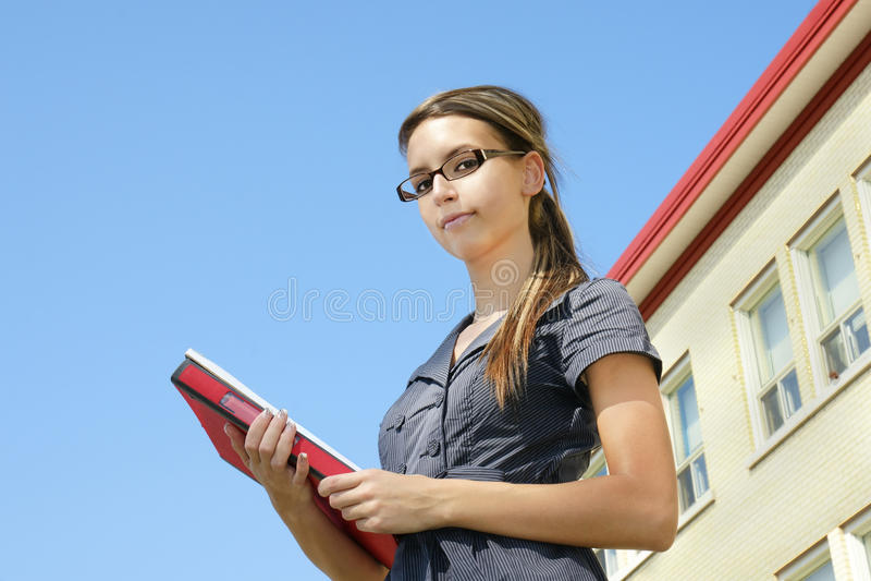Young woman looking down at camera stock image