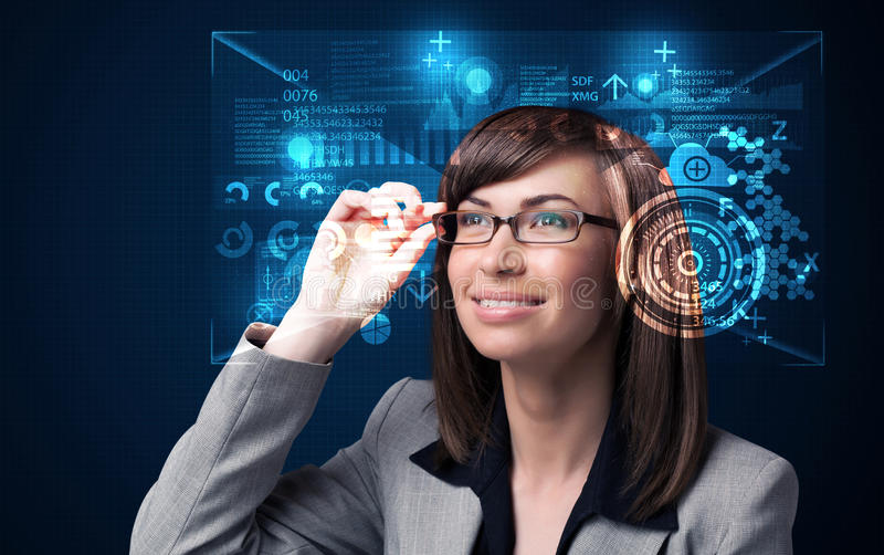 Young woman looking with futuristic smart high tech glasses stock image