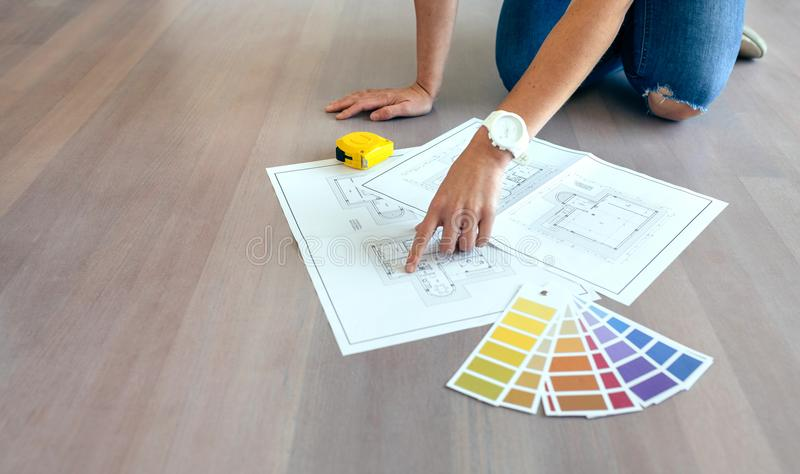 Young woman looking house plans stock images