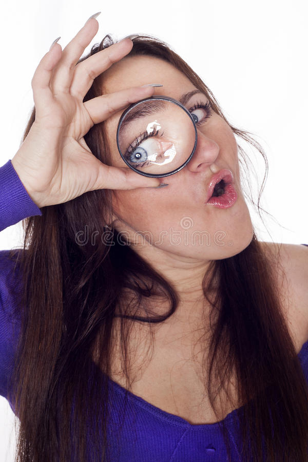 Young Woman Looking Through Loupe Stock Images