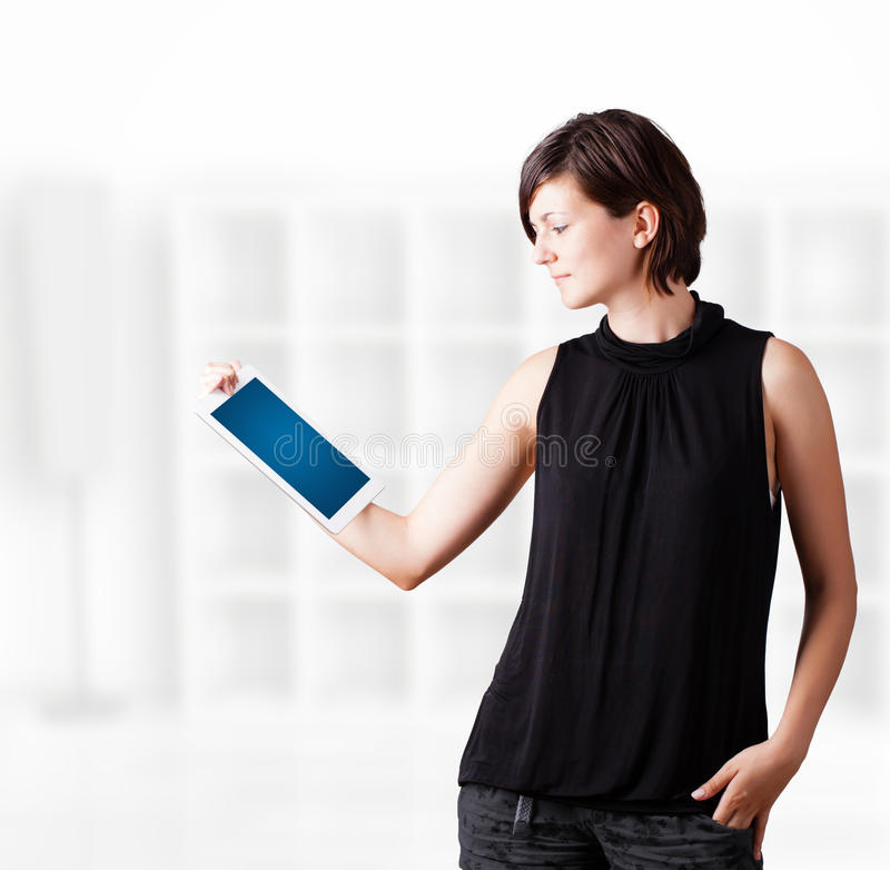 Download Young Woman Looking At Modern Tablet Stock Image - Image of laptop, corporate: 27643457