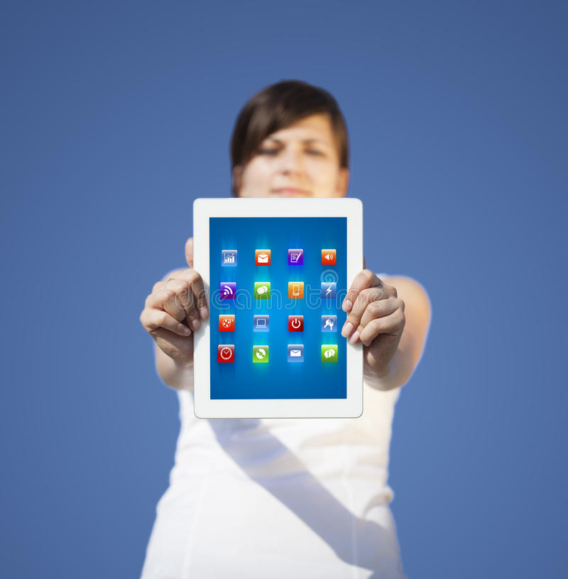 Download Young Woman Looking At Modern Tablet With Abstract Lights And Va Royalty Free Stock Images - Image: 28655949