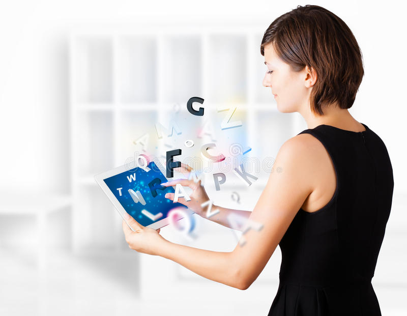 Download Young Woman Looking At Modern Tablet With Alphabet Royalty Free Stock Images - Image: 28655939
