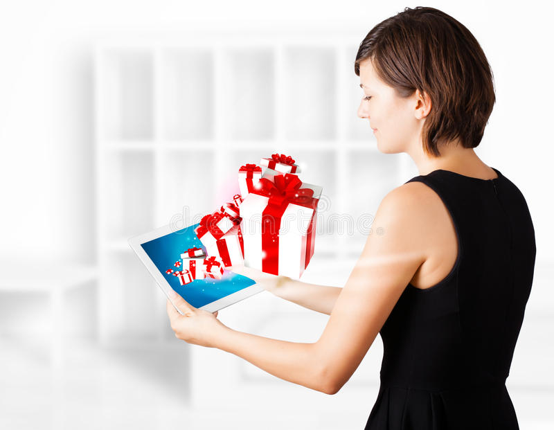Download Young Woman Looking At Modern Tablet With Present Boxes Stock Illustration - Image: 28249298