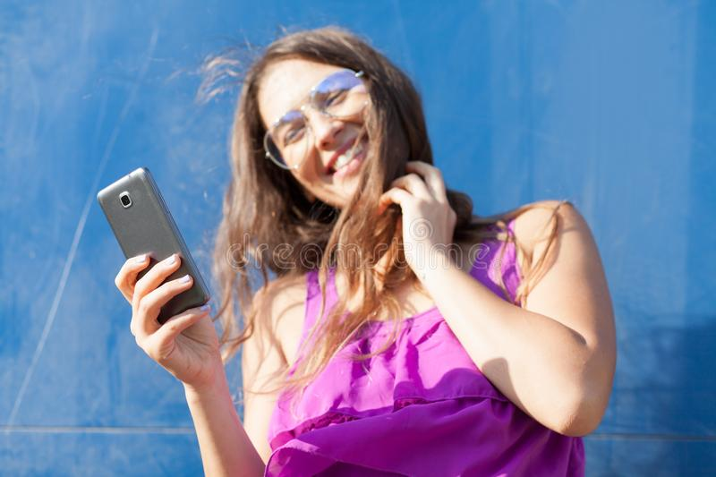 Young woman looking at smartphone stock photography