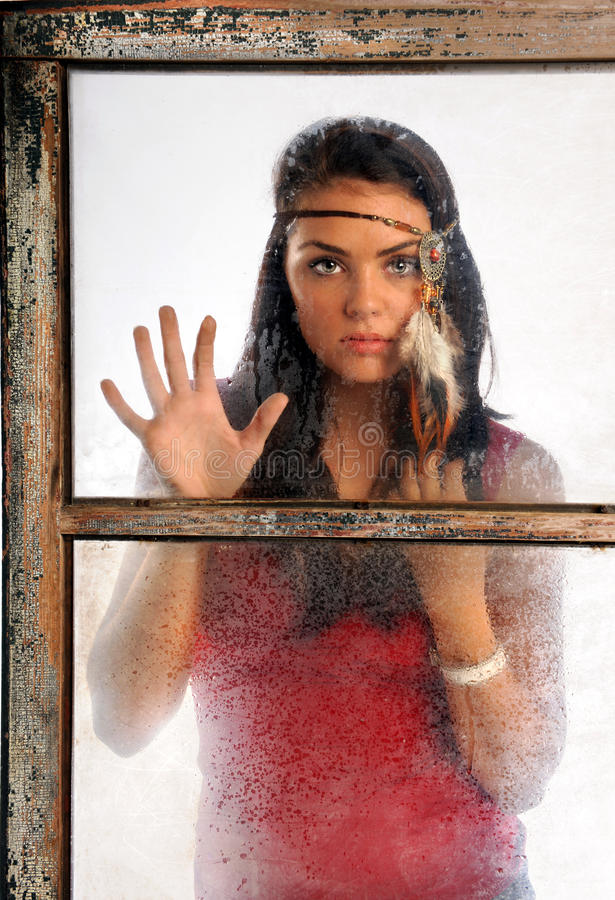 Young Woman Looking Through Window Royalty Free Stock Photo