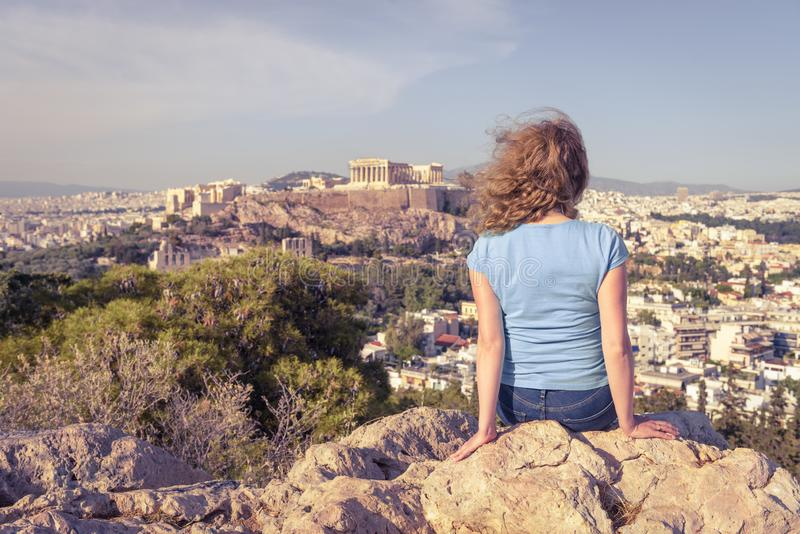 Young woman looks at cityscape of Athens from above, Greece stock image