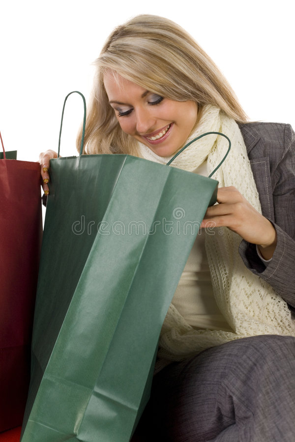 Young Woman Looks Into Shopping Bags Royalty Free Stock Photos