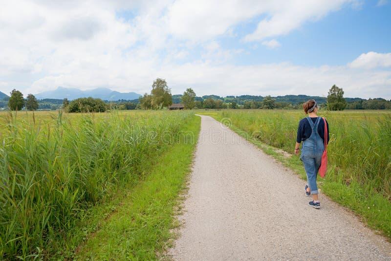 Young woman at loop road around chiemsee, bavaria stock photos