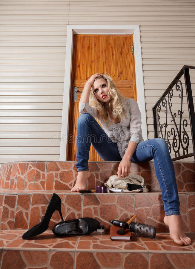 Young woman lost her house keys royalty free stock photo