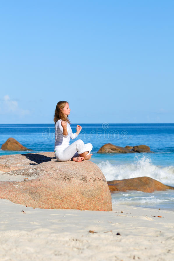 Young woman in lotus pose