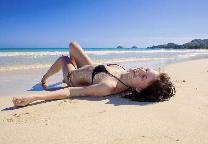 Young Woman Lounging At The Beach Royalty Free Stock Images