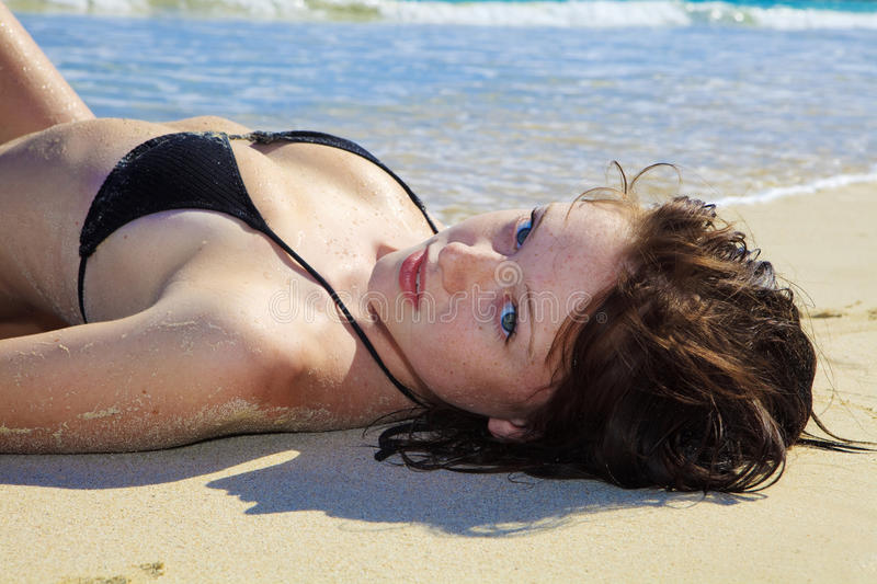 Download Young Woman Lounging At The Beach Stock Image - Image: 12597241