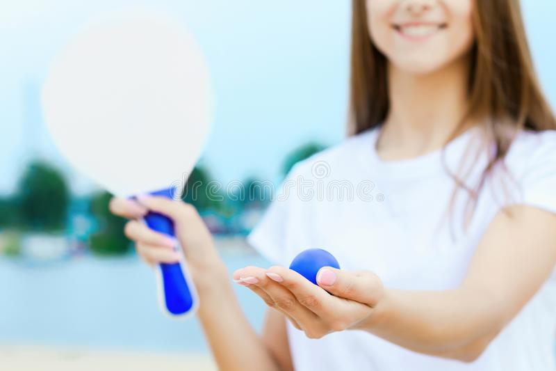 Young woman in love playing with matkot rackets stock photography
